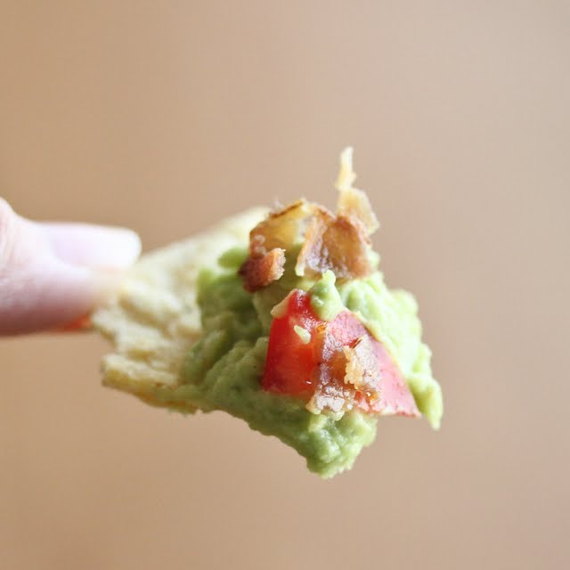 close-up photo of a chip with guacamole