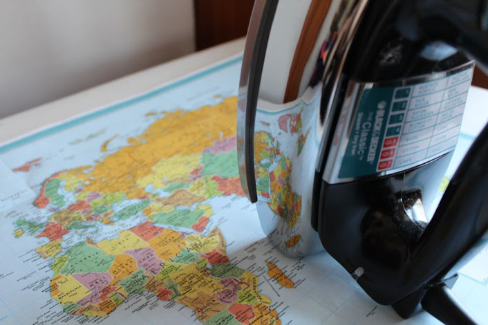 an iron and a map of the world
