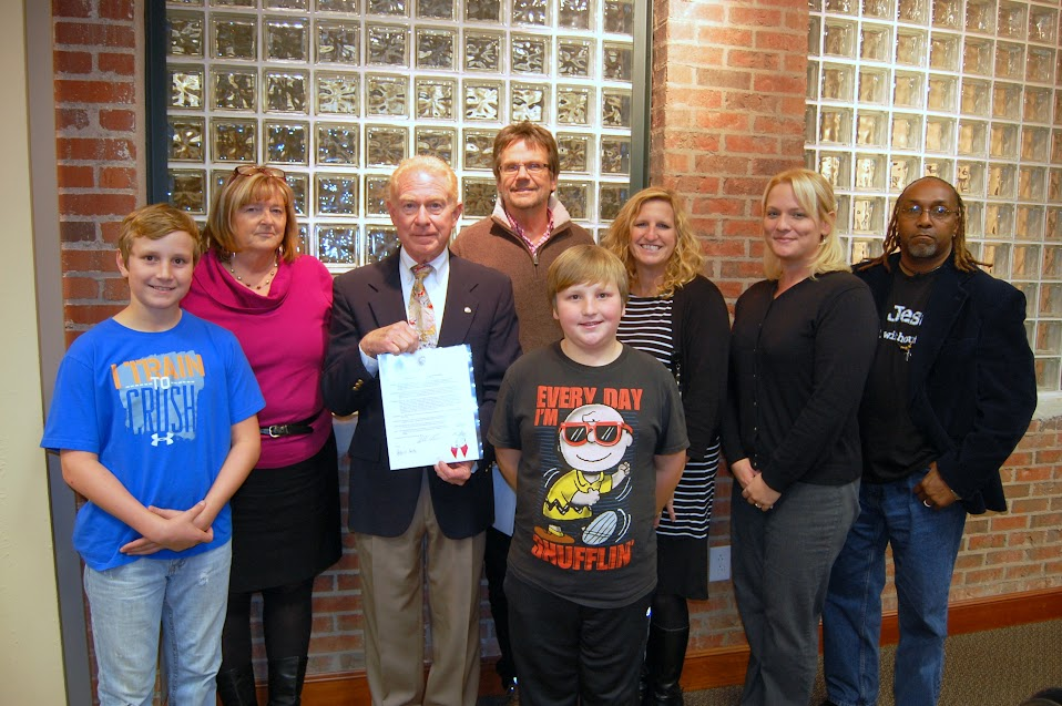Morganton Mayor Mel Cohen presents a proclamation to representatives of Burke Continuum of Care.