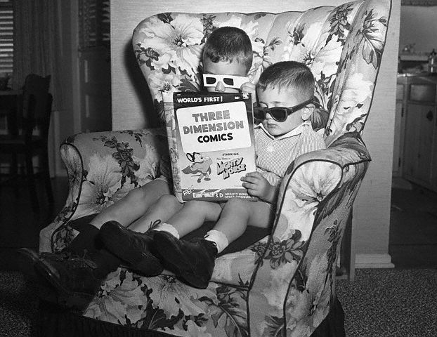17 Jun 1953, New York State, USA --- Original caption: 6/17/1953-Hicksville, NY: A popular outgroth of the popularity of 3-Dimensional movies is 3-D comic books, which has the children wearing various viewing glasses to see their favorite cartoon characters stand out on the pages. --- Image by © Bettmann/CORBIS