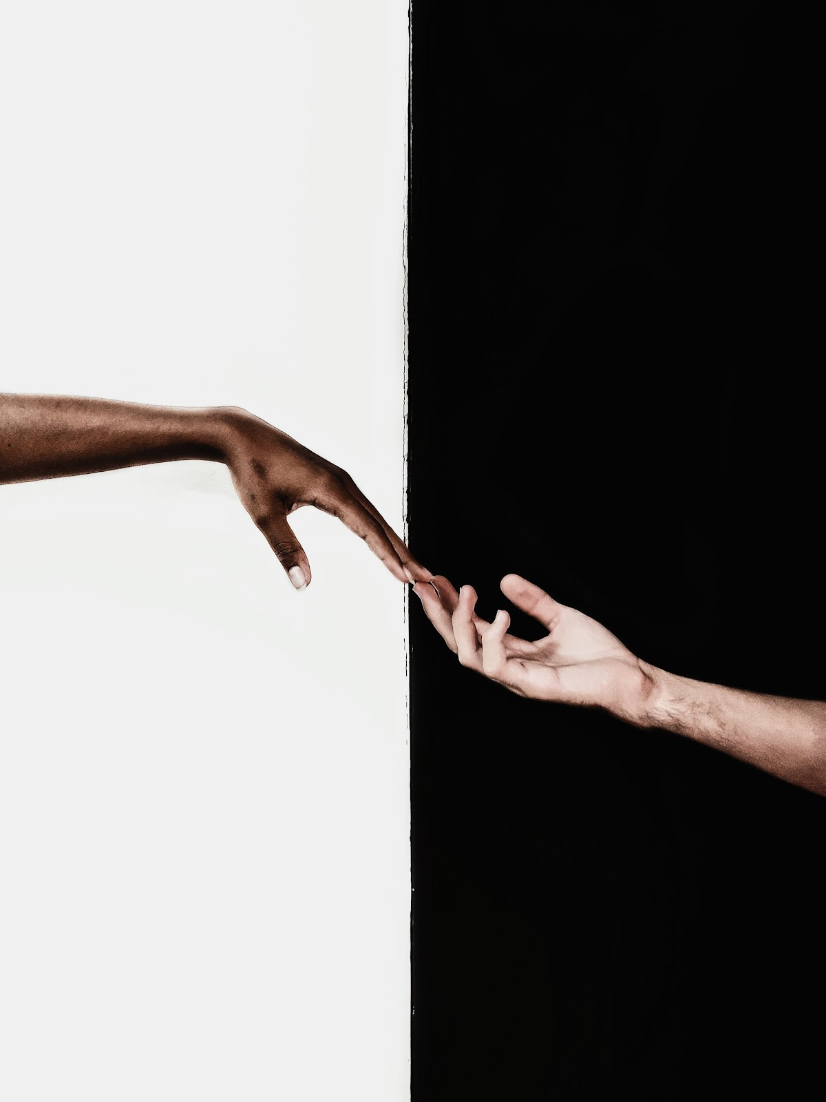 two hands trying to reach out to each other