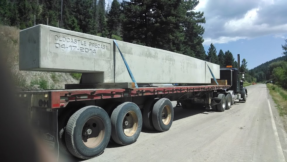 giant cement bridge piece loaded on a flatbed