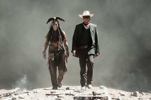 THE LONE RANGER Johnny Depp as Tonto and Armie Hammer
