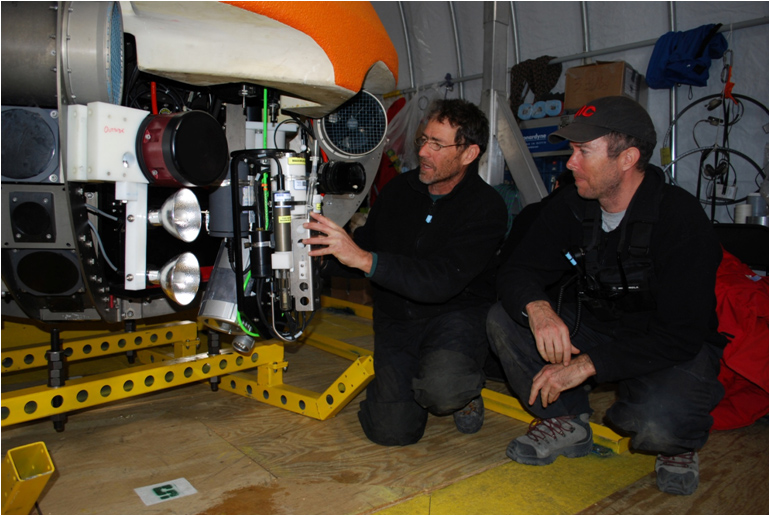 John Priscu and Peter Doran check the instruments mounted on ENDURANCE which will measure depth, conductivity, temperature, PAR, turbidity, chlorophyll fluorescence, DOM fluorescence, pH, and REDOX. (photo courtesy of Bill Stone, Stone Aerospace)