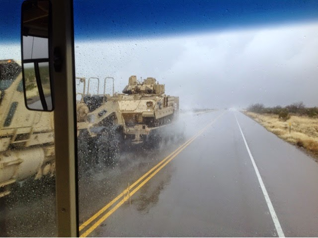Military transport passes us near Fort Bliss, TX in a driving rainstorm