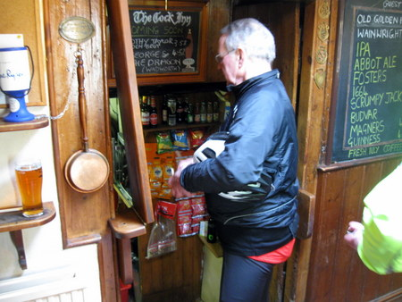 Man being served from pub cellar