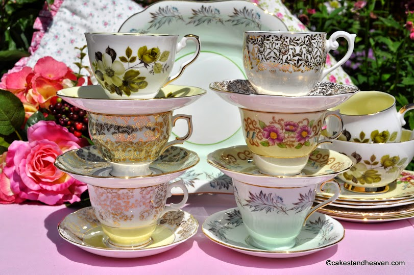 Six eclectic pastel coloured teacups and saucers