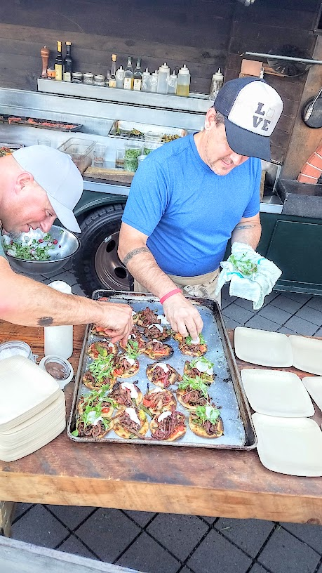 Red Hills Market created a Smoked Beef Brisket tostada with Mezcal flamed jalapenos, heirloom tomatoes, and cigar smoked avocados and radishes and micro cilantro for CigarBQue Portland 2016