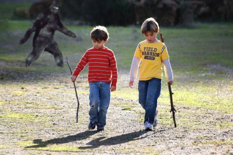 Sasquatch lurks between two children