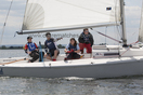 J/80 team racers sailing in London, England