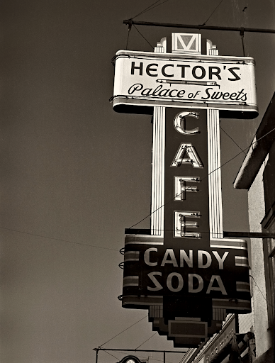 Neon sign for Hector's Palace of Sweets Cafe