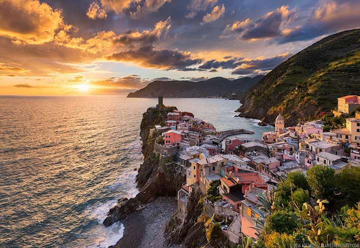 A phenomenal sunset in Vernazza, Cinque Terre Italy - one of the most beautiful travel destinations in the world. Photographer Elia Locardi