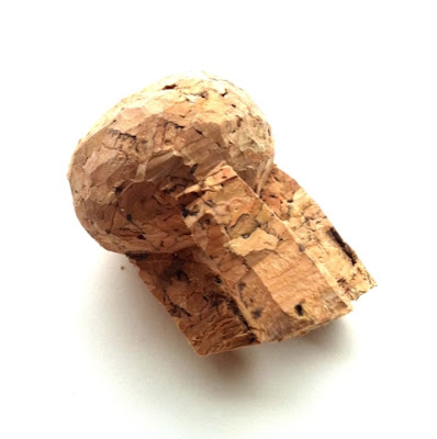 A champagne bottle cork whic has been carved into an abstract shape.