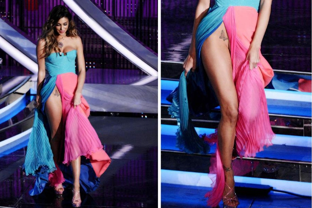 [belen rodriguez nuda sulla scena, ha un tatuaggio sulla coscia, gamba, vicino alle mutande che è scoperto dal vestito]