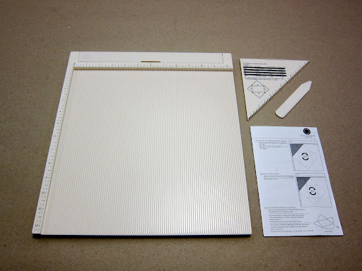 The kit comes with three pieces (the board, the envelope making triangle & the bone folder) plus basic instructions.