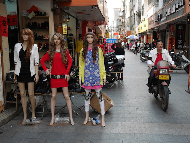 mannequins and a man on a motorbike in Yangjiang, China