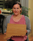 Amy Stringer Mowat holding a custom-made state-shaped cutting board - http://www.etsy.com/shop/Aheirloom