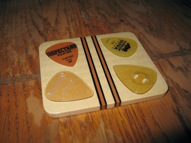 Plectrums on a Colin Symonds sycamore coaster
