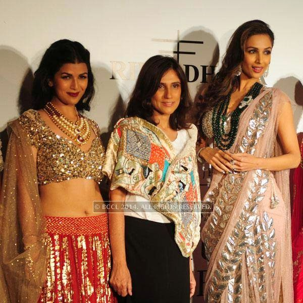 Nimrat Kaur , Rina Dhaka and Malaika Arora Khan during the Day 2 of India Couture Week, 2014, held at Taj Palace hotel, New Delhi.