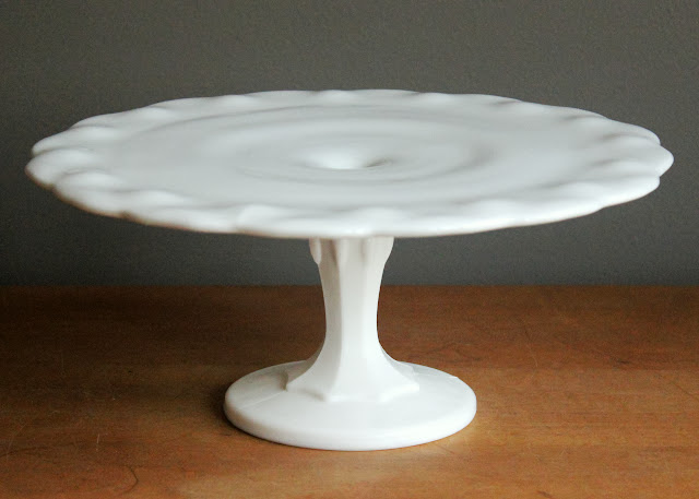 Milk glass teardrop cake stand available for rent from www.momentarilyyours.com, $6.00