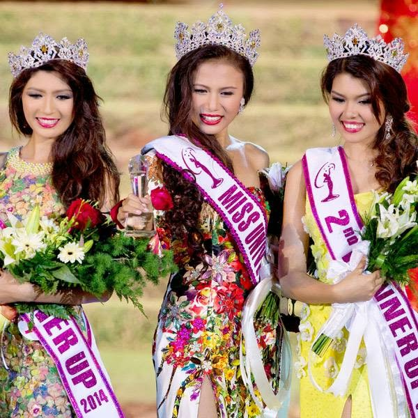 Winner of Miss Universe Myanmar 2014 Sharr Htut Eaindra, center, first runner up Yoon Mhi Mhi Kyaw, left, and second runner up Shwe Sin Ko Ko, right, pose for pictures during a pageant in Yangon, Myanmar, Saturday, July 26, 2014.