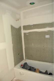 Picture of the hallway full bathroom shower just after drywall installed