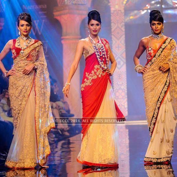 Models walk the ramp for Bridhichand Ghanshyamdas Jewellers on Day 3 of India International Jewellery Week (IIJW), 2014, held at Grand Hyatt, in Mumbai.<br />