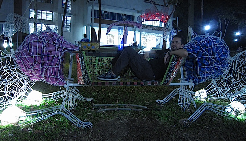 pair of big cats with a bench at Plet Bolipata's 'imagiNation' exhibit at the Ateneo de Manila University