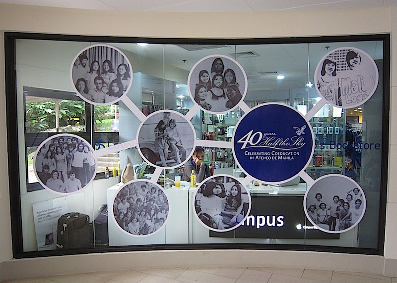 display at the window of the Loyola Schools Bookstore commemorating 40 years of coeducation in Ateneo de Manila