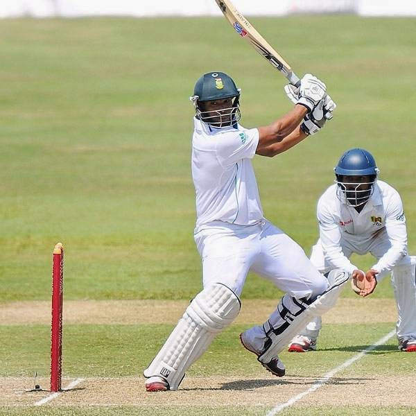 South Africa cricketer Vernon Philander (C) is watched by Sri Lankan wicketkeeper Dinesh Chandimal (L) and teammate Kaushal Silva as he plays a shot during the second day of the opening Test match between Sri Lanka and South Africa at the Galle International Cricket Stadium in Galle on July 17, 2014.