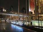 The sign for Lincoln Center with its electronic steps in the background