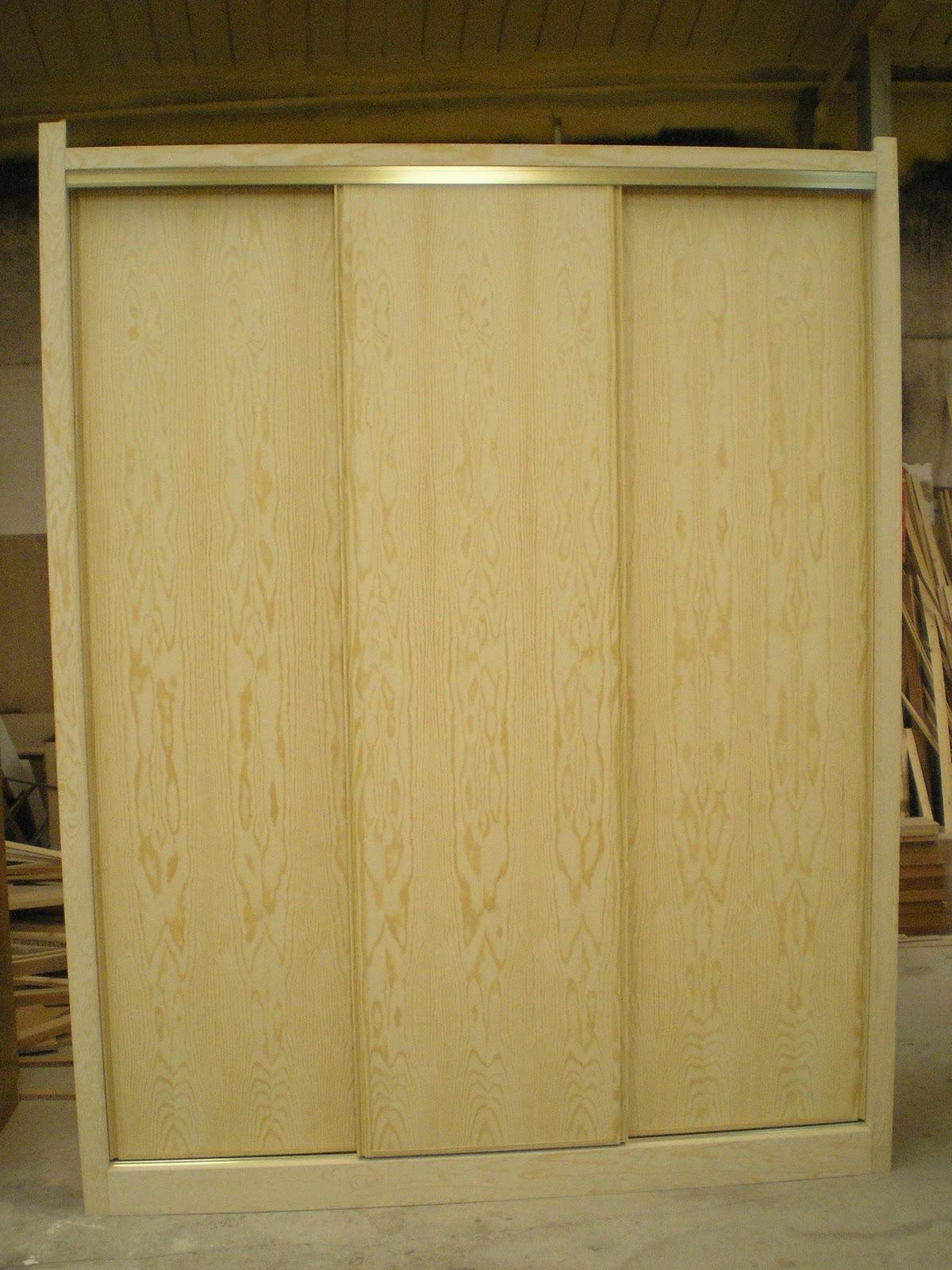Ebanisteria dmh montajes armarios puertas correderas re chapado de pino natural - Montaje de puertas ...