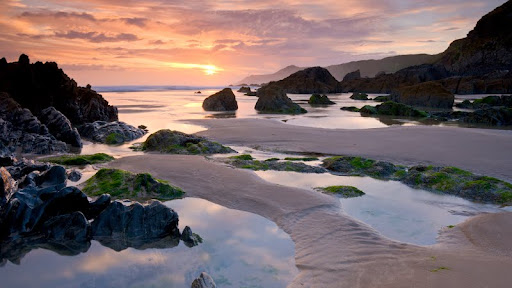 Sunset on Combesgate Beach, North Devon, England.jpg
