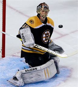 Tuukka Rask watches the puck