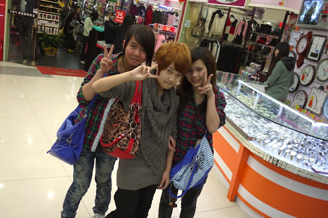 three young female shoppers posing for a photo in Nanping, Zhuhai, China