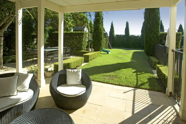 A wicker verandah setting at 16 Bradleys Head Road Mosman