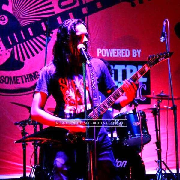 Lead guitarist and vocalist Joel Mogera during the performance of Spikedhead at the weekend show of Rock Studio at R3 mall in Ahmedabad.