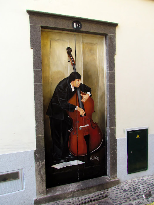 music in a door - Santa Maria street in old town