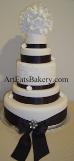 5 tier custom unique elegant Black and white wedding cake design with sugar orchid flower topper, ribbons, bow and brush embroidery