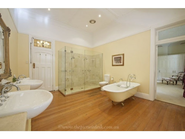 Original period bathroom with updated twin shower stall and twin handbasins and the loo has been installed.