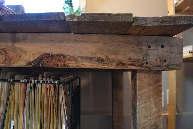 Live wood edges on this desk frame share the reclaimed wood details on this magnificent 12 foot desk build!