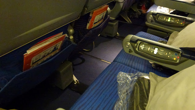 Empty Qantas 747 seats, blue in colour.