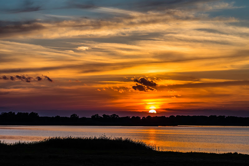 [VERY DYNAMIK SUNSET OVER A SEA IN EAST GERMANY.]