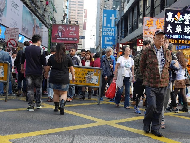 older man walking at Sai Yeung Choi Street South