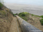 One of the two ropes leading down to the beach