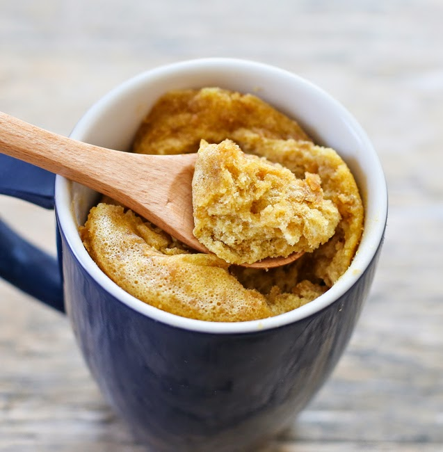 photo of a spoon dipping into a flourless peanut butter mug cake