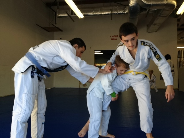 Kids Martial Arts doing takedowns.