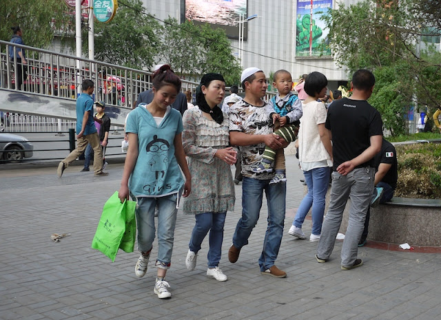 people on sidewalk in Xining, Qinghai, China