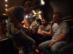 Josh shows off a new guitar on his bus