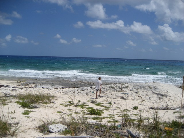 Grant exploring beach on Exuma Sound, Great Guana Cay